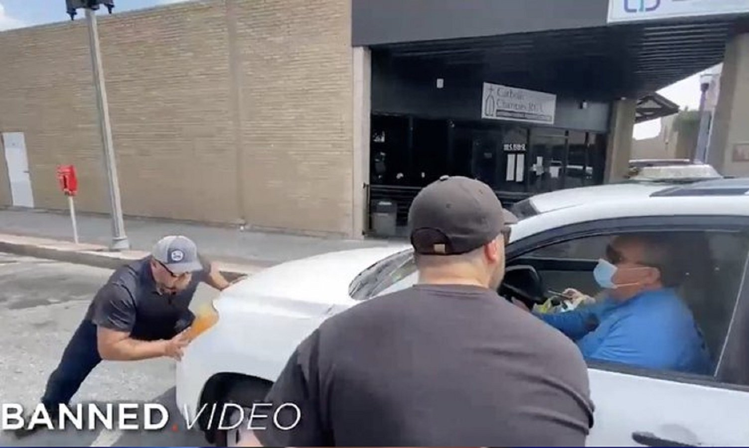 WATCH: Alex Jones Physically Stops Vehicle After Witnessing Migrant Children Being Stuffed in the Luggage Compartment