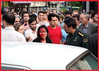 iran bloody woman