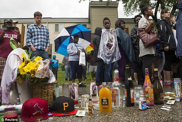 liquor bottles shrine michael brown