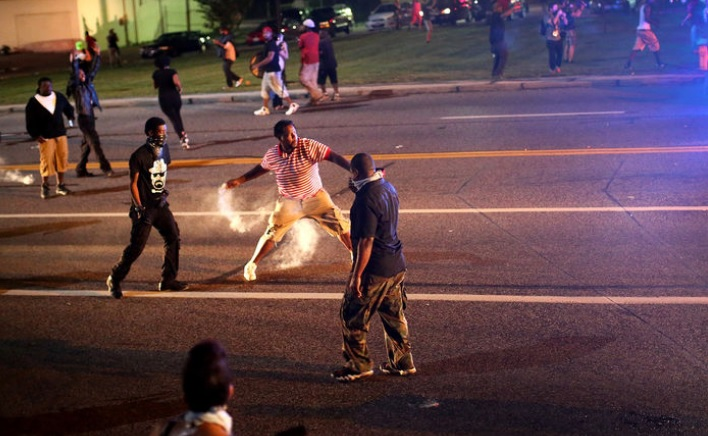 ferguson police officers rioters