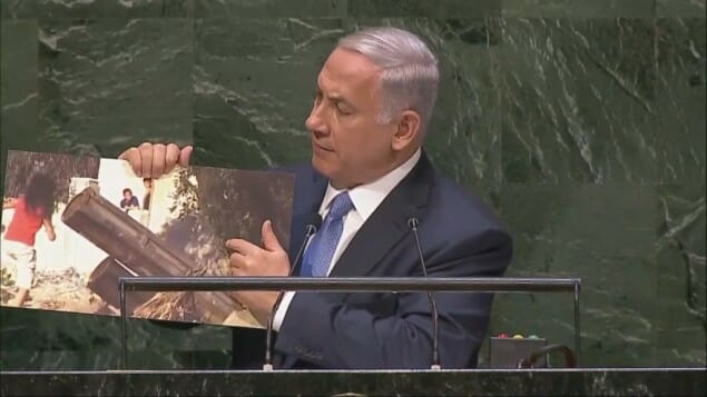 NETANYAHU SHOWS PHOTO OF HAMAS WAR CRIMES AT UN – Rocket Launcher Next to Kids (Video)