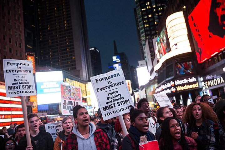 Revolution Communist Party Providing Ferguson Protest Signs Across The Country