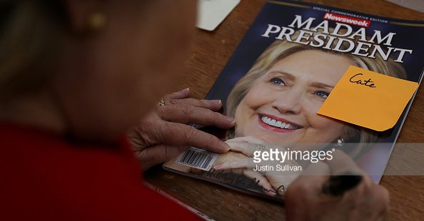hillary-clinton-signing-newsweek-madam-president-cover-justin-sullivan-twitter