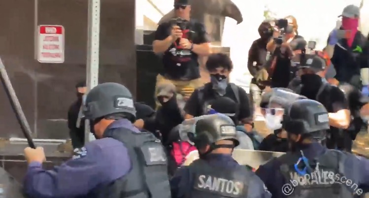 Police beat Antifa terrorists with batons outside Wi Spa in Los Angeles and declare meeting illegal (VIDEO)