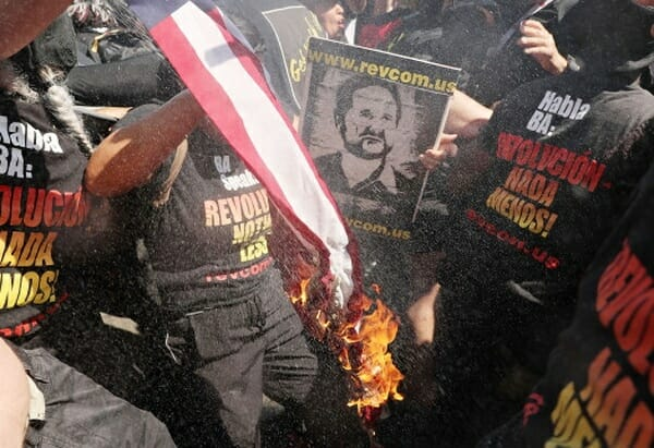 RNC Protesters burn flag