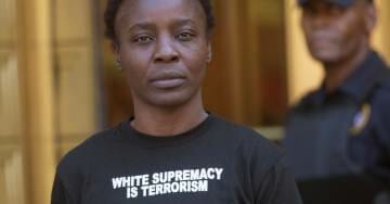 Anti-White Congolese Activist and Immigrant Who Assaults Cops and Climbed Statue of Liberty Says Trump Is a 'Monster'
