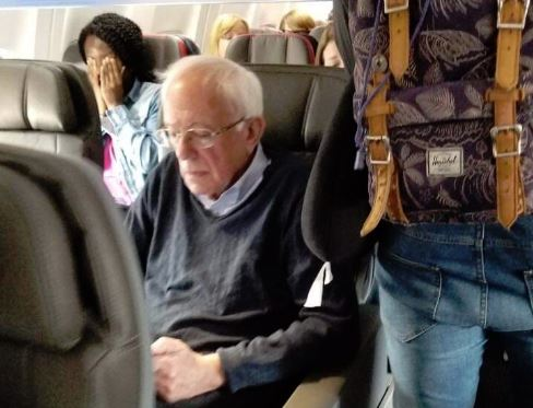 Good Ol' Socialist Bernie Sanders -- A Bum Who Earned His First Paycheck at Age 40 -- Is Caught Flying First Class to Dem Debate