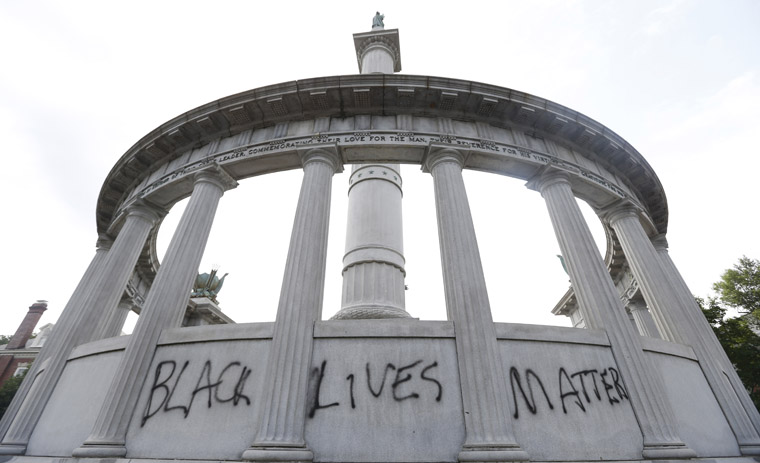 "A spray painted message of ""Black Lives Matter"" was painted on a monument to former Confederate President Jefferson Davis on Monument Avenue in Richmond, Va., Thursday, June 25, 2015.  The vandalism comes after a mass shooting in Charleston South Carolina has sparked a nationwide debate on the public display of Confederate imagery.  (AP Photo/Steve Helber)"