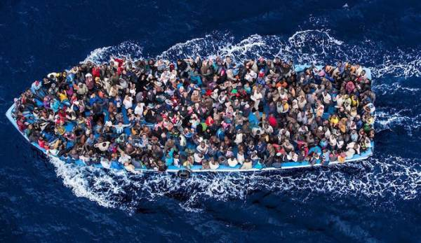 photo image Gratitude: African Migrants Rescued Off the Coast of Libya Threaten to Behead Rescuers