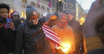 Black Lives Matter Activists Torch American Flag At Apple Rally