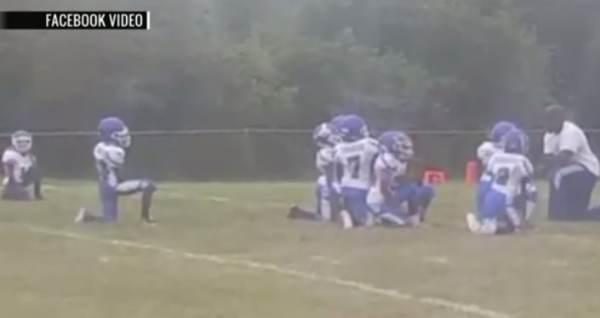 DISGUSTING! 8-Year-Old Football Team and Coach Take a Knee During National Anthem to Bash Cops (Video)