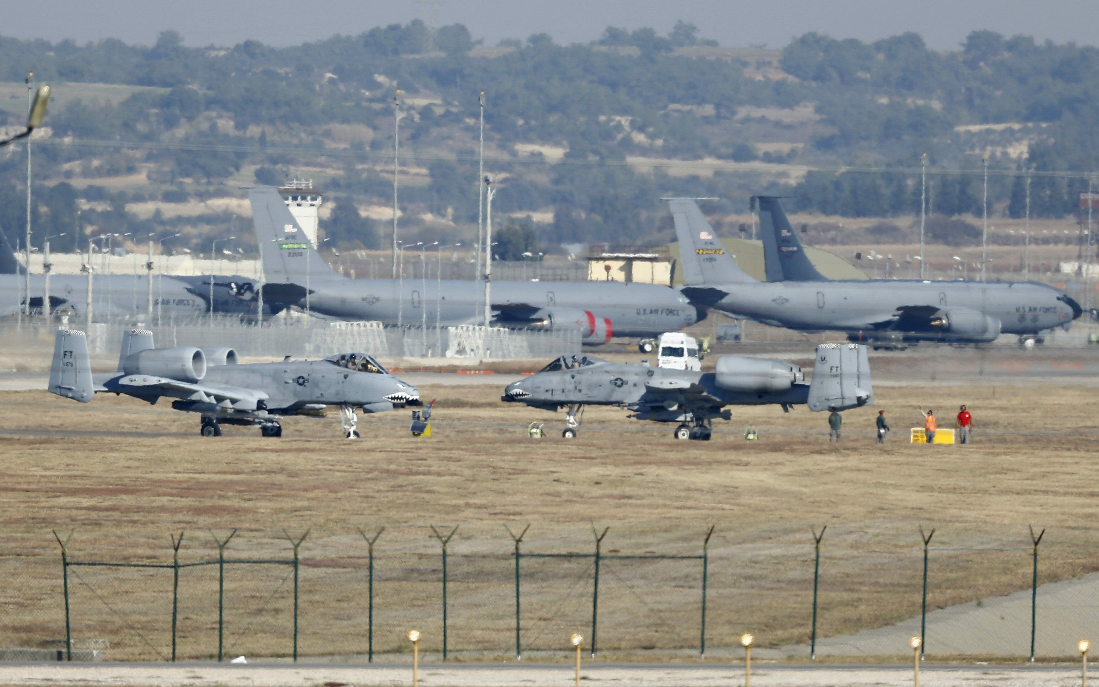 U.S. Air Force A-10 Thunderbolt II fighter jets (foreground) are pictured at Incirlik airbase in the southern city of Adana, Turkey, December 11, 2015. REUTERS/Umit Bektas