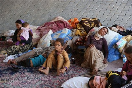 Displaced Iraqis from the Yazidi community settle under a bridge in Dahuk, 260 miles (430 kilometers) northwest of Baghdad, Iraq, Thursday, Aug. 14, 2014. The United Nations has announced its highest level of emergency for the humanitarian crisis in Iraq in the wake of the onslaught by Islamic militants who have overrun much of the country's north and west and driven out hundreds of thousands from their homes. (AP Photo/ Khalid Mohammed)
