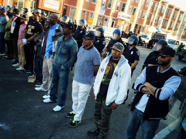 Police Lives Matter: Real Men Line Up & Lock Arms to Protect Baltimore Police