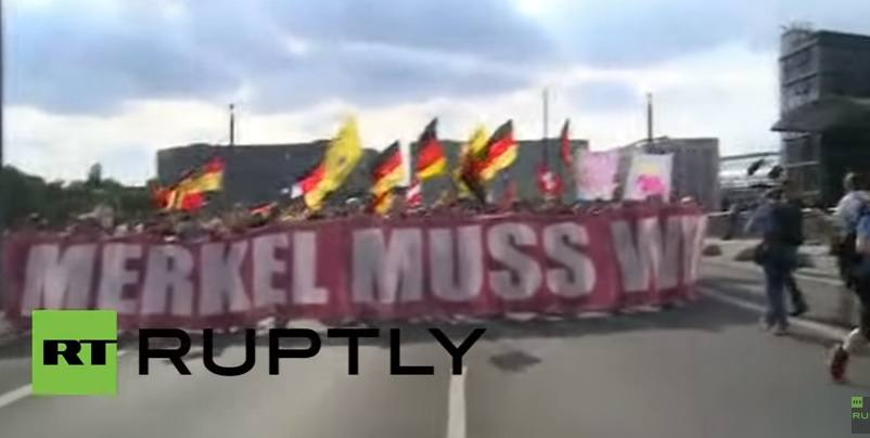 merkel protest refugee