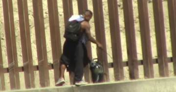 VIDEO: Why Is This Mexican Spraying The New Mexican Border Wall in Tijuana?