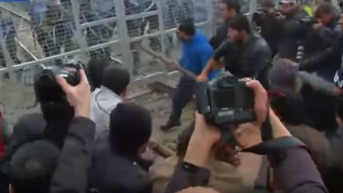 DESPERATE MIGRANTS Use Battering Ram to Bust Through Macedonian Border (VIDEO)