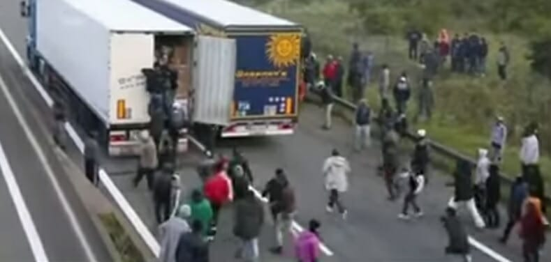migrants trucks