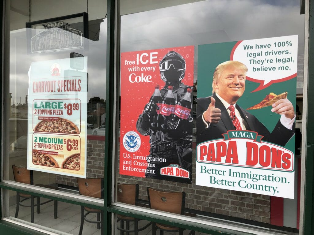 photo image Always Spicy. Papa Dons Pizza Restaurant Plasters President Trump on Their Front Window – Promises 'No Illegal Drivers'