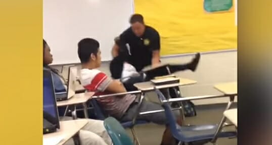 school beating cop