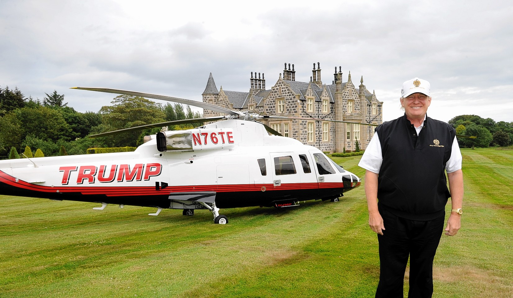 Donald Trump with his new helicopter at Trump International Golf Links, Aberdeen. Picture by KEVIN EMSLIE