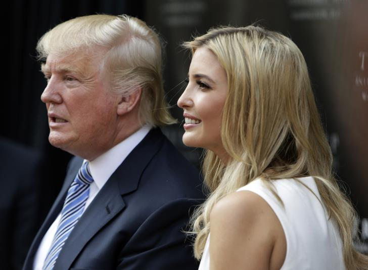 Donald Trump and his daughter Ivanka (R) attend the ground breaking ceremony of the Trump International Hotel at the Old Post Office Building in Washington July 23, 2014. The $200 million transformation of the Old Post Office Building into a Trump hotel is scheduled for completion in 2016.  REUTERS/Gary Cameron    (UNITED STATES - Tags: BUSINESS POLITICS REAL ESTATE)