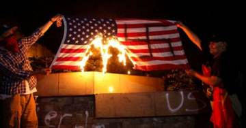 Grateful Hondurans Paint Swastika on US Flag Then Torch It in Support of Illegal Immigrant Caravans